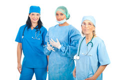 Smiling team of three surgeons women Stock Photography