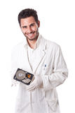 Smiling Technician holding hard disk. A technician wearing lab coat holding an hard disk drive Stock Photos