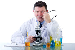 Smiling Technician  at laboratory. Smiling Technician with microscope  at laboratory Royalty Free Stock Image