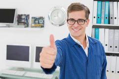 Smiling technician looking at camera showing thumbs up Royalty Free Stock Image