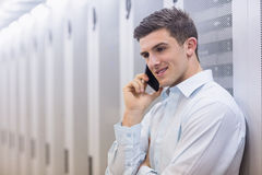 Smiling technician on the phone Royalty Free Stock Image