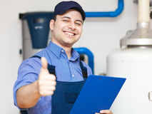 Smiling technician repairing thumbs up Royalty Free Stock Photos