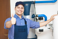 Smiling technician repairing thumbs up Royalty Free Stock Photography