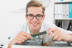 Smiling technician working on broken cpu Stock Image