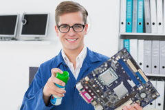 Smiling technician working on broken cpu Royalty Free Stock Photography
