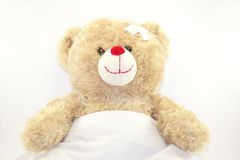 Smiling teddy bear is sicking Royalty Free Stock Images