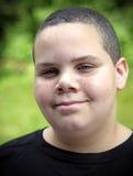 Smiling teen. Smiling latino teen boy portrait outdoors Stock Image