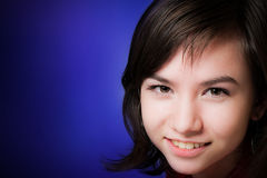 Smiling teen. Young beautiful smiling teen girl studio portrait Royalty Free Stock Photography