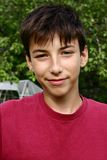 Smiling teen. Boy. Outdoor portrait royalty free stock image