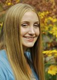 Smiling Teen. Young blond teen smiling for her portrait outside Stock Photography