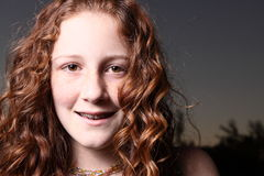 Smiling teen. Young teen smiling and showing her braces Royalty Free Stock Photography