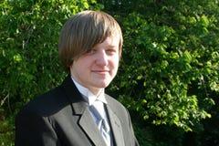 Smiling Teen Boy In Black Tuxedo Horizontal Stock Image