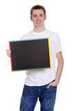 Smiling teen boy with chalkboard Royalty Free Stock Image