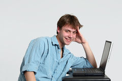 Smiling teen boy at computer Royalty Free Stock Photo