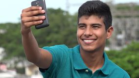 Smiling Teen Boy Taking Selfy stock footage