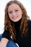 Smiling teen with curly hair. Smiling beautiful girl with long curly hair Stock Photo