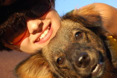 Smiling teen with a dog. Waiting for sunset stock photo