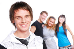 Smiling teen face. Portrait of a young beautiful teen boy. Friends on a background Stock Photography