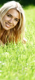 Smiling teen in field Stock Images