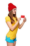 Smiling teen funky girl holding blank credit card Stock Photos