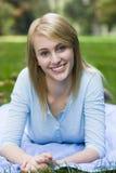 Smiling Teen Girl. Lying on Blanket in Park stock photos
