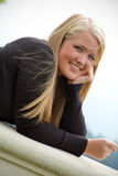Smiling Teen Girl on Balcony Royalty Free Stock Photos