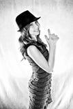 Teen girl making a gun gesture Stock Photo