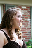 Smiling Teen Girl In Brown Gown Stock Photo