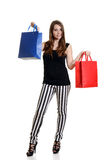 Smiling teen girl with colorful shopping bags Stock Image