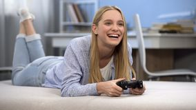 Smiling teen girl gamer playing game with joystick, happy to win, positivity. Stock photo royalty free stock photos