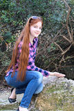 Smiling teen girl in a garden Royalty Free Stock Images