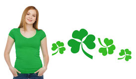 Smiling teen girl in green t-shirt with shamrock Stock Photo