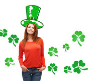 Smiling teen girl in green top hat with shamrock Stock Photography