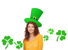 Smiling teen girl in green top hat with shamrock Royalty Free Stock Photography