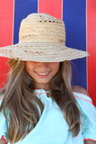 Smiling teen girl in hat on beach. Close up royalty free stock photos