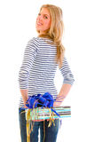 Smiling teen girl hiding present behind back Stock Photography