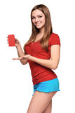 Smiling teen girl holding blank credit card Royalty Free Stock Photos