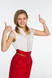 Smiling teen girl holds her thumbs up Royalty Free Stock Photo
