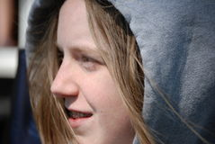 Smiling teen girl in hoodie. A smiling teenage girl with braces in hoodie Royalty Free Stock Photography