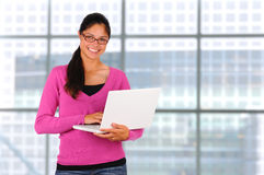Smiling Teen Girl with Laptop Stock Photography