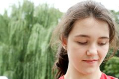 Smiling teen girl looking down royalty free stock images