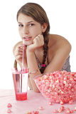 Smiling teen girl with pink popcorn Royalty Free Stock Photo
