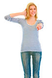 Smiling teen girl showing contact me gesture stock photo