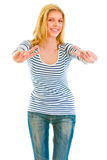 Smiling teen girl showing victory gesture Royalty Free Stock Photos