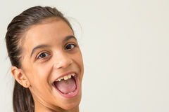 Smiling teen girl, side face Royalty Free Stock Photos