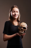 Smiling teen girl with skull Royalty Free Stock Image