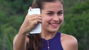 Smiling Teen Girl Taking Selfies stock video footage