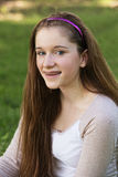 Smiling Teen Girl. Smiling teenage white female with braces on teeth Royalty Free Stock Photos