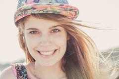 Smiling teen girl wearing floral cap Royalty Free Stock Image