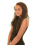 Smiling teen girl. Young brunette teen wearing a brown dress posing with a smile or grin on her face Royalty Free Stock Photos